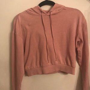 Pink cropped H&M hoodie.